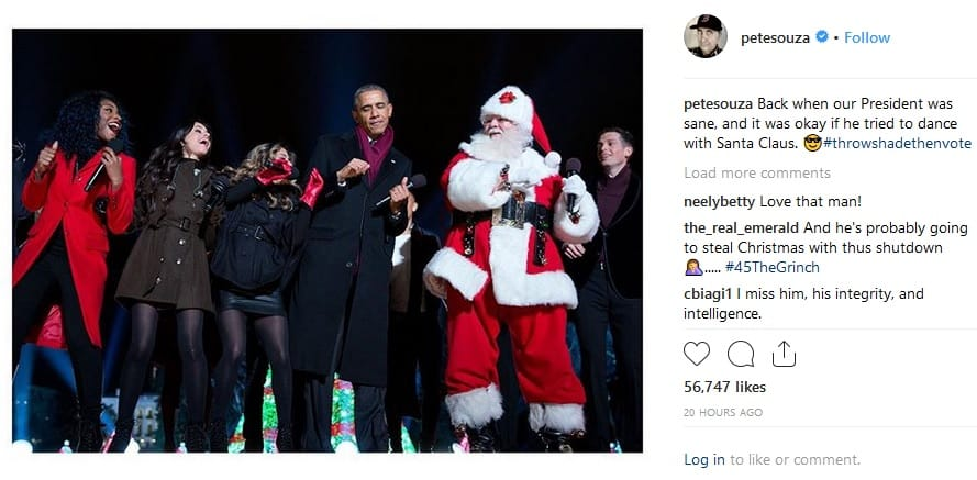 Obama dancing with Santa Claus