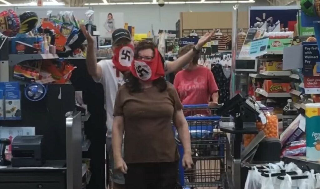 walmart bans Nazi swastika mask couple