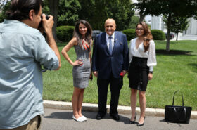 OANN Chanel Rion poses with Giuliani